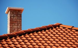 tile roofing with re-pointed chimney in bingham notts
